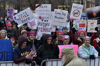 Women's March brings out hundreds of thousands across US as Trump tweets in response