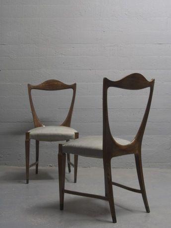 An important pair of mahogany & ebony side chairs by Paolo Buffa