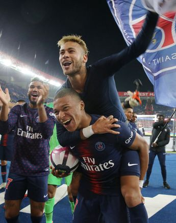 Kylian Mbappe of Paris Saint-Germain celebrates the victory and his...