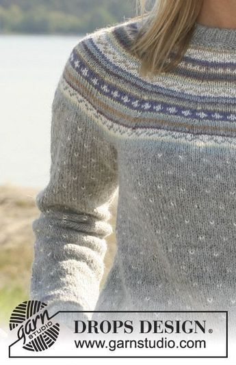 """b558eec2cf8e2 DROPS jumper in """"Alpaca"""" with round yoke and multi coloured pattern. Long or"""