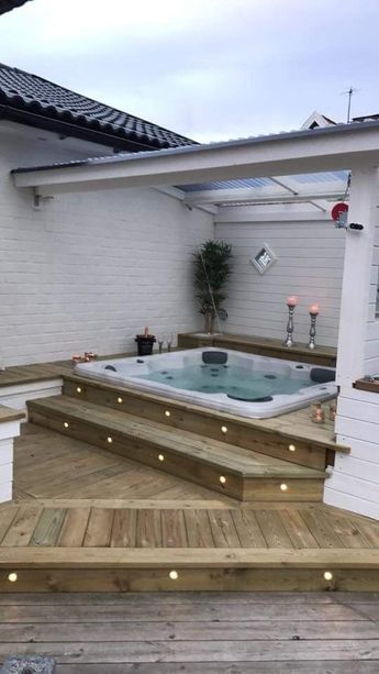 Lined scorching bath constructed into again deck - #built #Covered #Deck #hot #tub