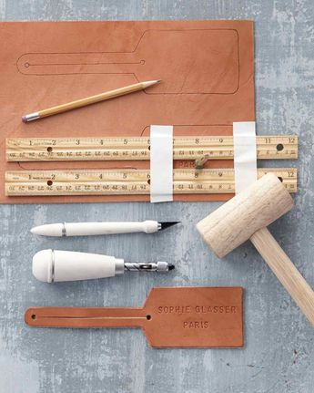 """SourcesAlphabet and number set, 1/4"""", $30; and single shoulder of leather, 4–5 oz., $39, michaels.com Craft knife, $12, and screw punch, $25, by Martha Stewart Crafts, michaels.com"""