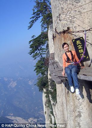 What could possibly go wrong? The tourist trek thousands of feet up a Chinese mountain along wooden boards that were nailed together 700 years ago