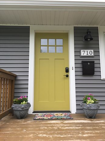 Antiquity by Sherwin Williams Front Door with Charcoal Gray siding. Oil Rubbed Bronze hardware and mailbox.
