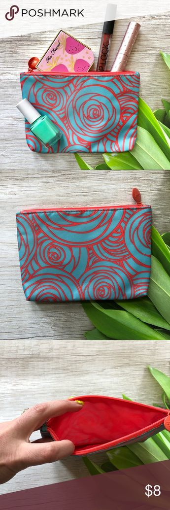 NWOT Coral Orange and Blue Floral Makeup Bag NWOT Cute makeup bag that has room to hold plenty of your everyday essentials. Bag has a coral orange and bright blue floral like pattern.  Has a coral inner lining and a zip enclosure.   Perfect to use as a gift bag for the upcoming holidays or that little gift for someone.   Please ask questions and happy poshing Bags Cosmetic Bags & Cases