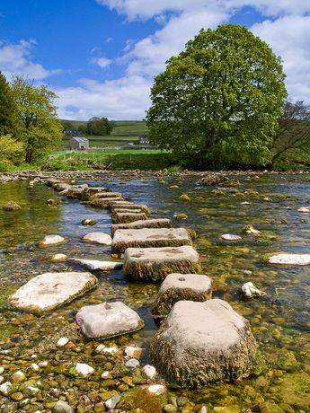 Stepping stones across the River Wharfe in Hebden - North Yorkshire, England