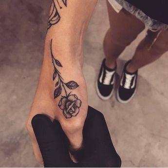 Rose thumb tattoo