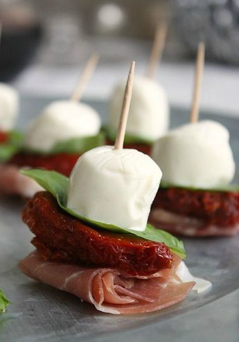 Get creative with your finger foods during the summer + make a batch of Antipasto Mini Skewers with this easy recipe.