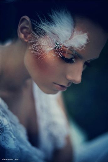 Beautiful feather and crystal accents with copper eye shadow and cheeks.