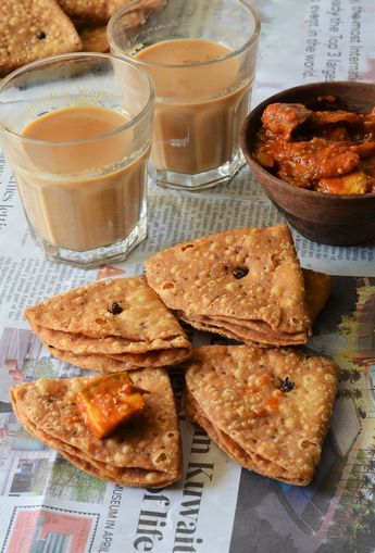 Khasta trikoni mathri,Namkeen khaja Perfect recipe to try this Diwali,a crisp and layered savoury cracker,you can serve it as a tea time snack or drizzle with curd,green chutney and tamrind chutney and serve as a chat