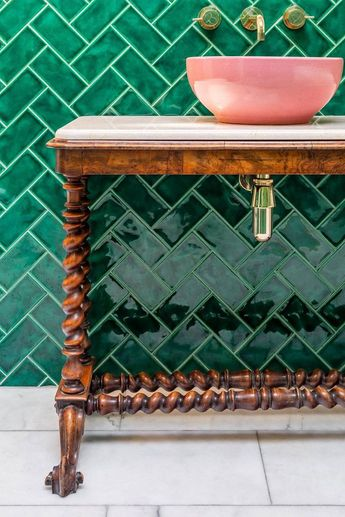 Pink basin against emerald green metro tiles