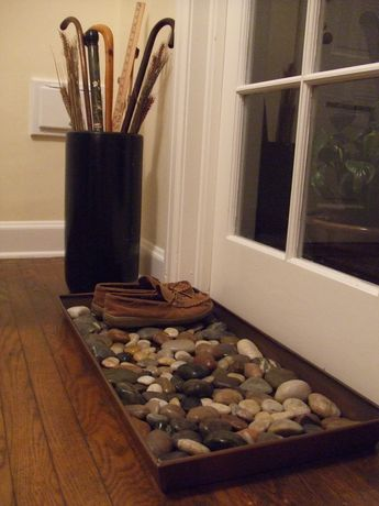 add a boot tray with rocks to have less mess in entyway..rocks drain water so your shoes will dry faster when they are wet.