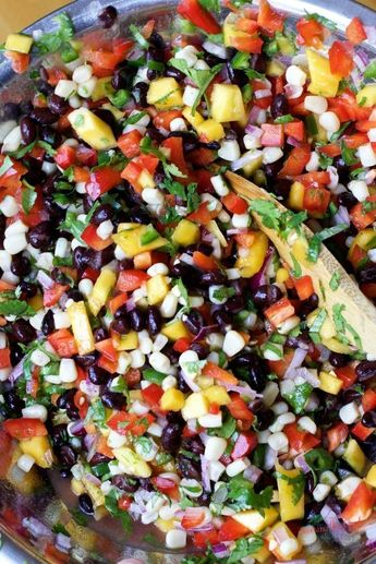 Here is an easy salsa recipe that can be made year round. The combination of canned black beans, canned corn kernels and the fresh mango will keep your chip reaching for another dip. Make ahead of time and store in the refrigerator for a healthy snack thr