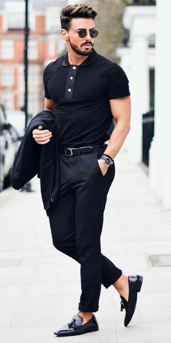 All black outfit. Monochrome. Jacket, shades, and hairstyle set-off the look.