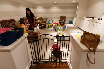 If you go to this website, it shows a few other pictures of their nursery. I love how there is so much space for parents to walk in and hang their babies stuff up and check in. Doesn't show it in this picture, but the others on the website. Very functional!