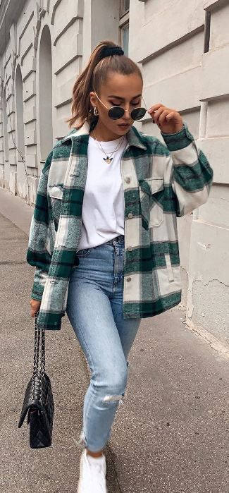 Beautiful jeans and coat plaid.Autumn is at the door, and with it new fashion trends. Beautiful jeans and coat with tee. Beautiful clothing of all designs and creations are here!