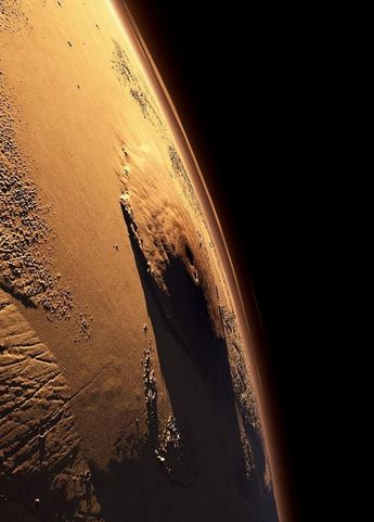 Olympus Mons the largest volcano in our solar system located on the planet Mars. Astronomy, space, stars, science,