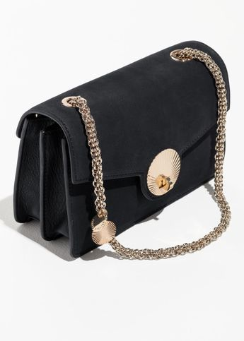 8ac5ebf89cb7 Embossed Lock Crossbody Bag