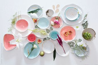 From above photo of beautifully decorated porcelain handmade dishes.
