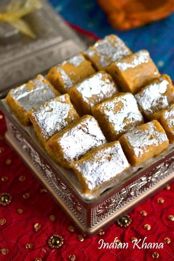 Besan-Mawa-Burfi-recipe1 Cups - Besan/Chickpeas Flour 1/2 Cup - Mawa/Khoya 1/2 Cup - Condensed Milk 1/4 Cup - Powdered Sugar 1 tbsp - Chopped Cashew nuts 2 tbsp - Ghee 1 tsp - Cardamom Powder 1 - Sliver Warq [optional]