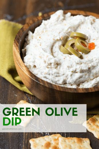 Tangy and full of flavor, this Easy Green Olive Dip always disappears. You're only 5 ingredients away from the bowl of goodness. #dips #partyfood #easyentertaining #olives