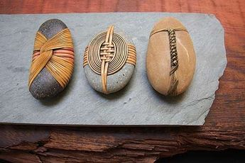 "by Deloss Webber Bento Series beach stones, rattan, slate "" The energy is transcendent of the physical structure - stone, fiber, and wood rise above the earthly elements that comprise their visual presence. Del's reverence for nature takes shape as varying types of stones are wrapped fiber - rattan, bamboo, cane or reed. The melding of contemporary weaving techniques in concomitance with classic Japanese knotting styles gives Del's sculpture a unique appearance."