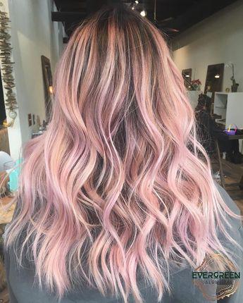Pink color pastel hair medium long length wavy curls