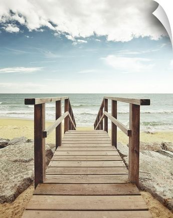 Beach with wooden pier in Spain