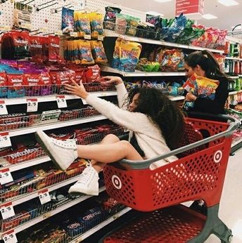 If that was me and my BFF I would push the cart across the ally and have her hit the wall