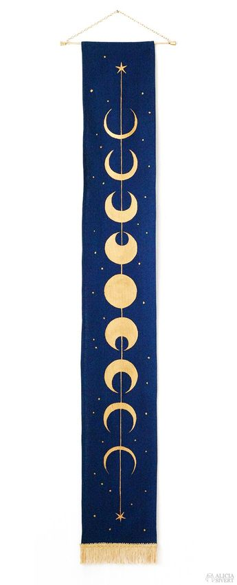 Moon phase wall hanging by Alicia Sivertsson. Inspired by the duelling club rug in Harry Potter and the Chamber of Secrets.