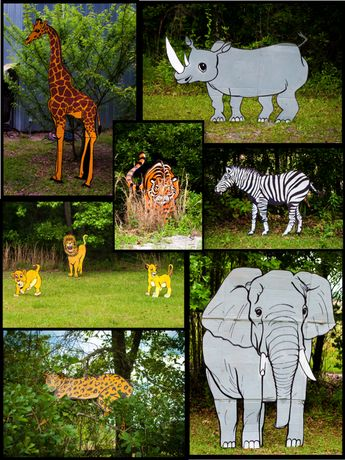 """Cardboard safari animals on wooden stakes. First birthday activity... the kids rode a decorated golf cart to experience the """"safari adventure""""."""