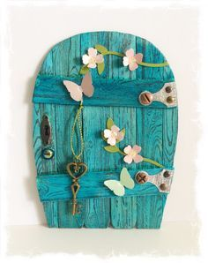 Handcrafted Fairy Door / Gnome / Pixie Door (Teal Blue Arch)_ 14cm tall by 11cm wide with a thickness of approximately 4mm._1120