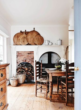 A white weatherboard cottage filled with antiques