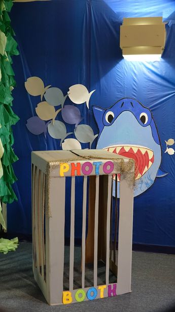 Photo booth-shark cage w/Bruce made by my partner in decorating, Kelcey. Bruce hung by filament from light fixture then stabilized w/tape onto plastic table cover.