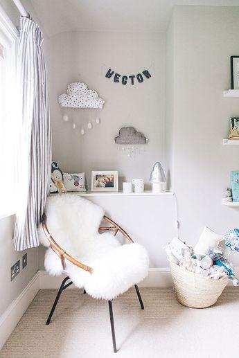 A modern stylish unisex baby nursery with a neutral grey colour scheme.