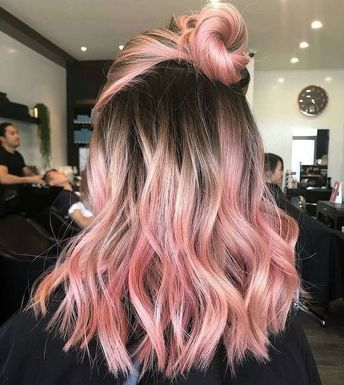 brown to rose gold, pink hair in a bun, medium length, wavy hairstyle, blonde ombre hair