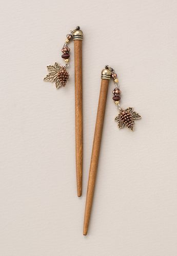 Autumn maple leaf and pinecone with mixed metals accents. Limited release available while supplies last. Download the Stylist Marketing Pack for this product. Plating: Nickel, Burnished Copper, Goldtone, Antique Brass Lite wood