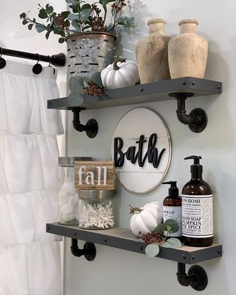I added some simple fall touches to my bathroom shelves!🍂 The pumpkins are slowly making their way through the house! I'm also loving the…