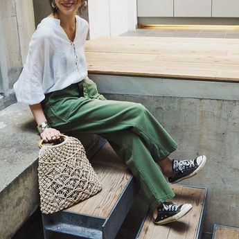 White blouse, green trousers, black Converse & knitted bag