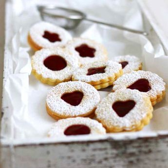 Traditional German Christmas Cookies with raspberry jam filling. (in English and German)