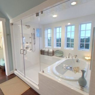 Yes!! Enclosed tub/shower combo - just need dual shower heads and different tile and this is perfect. If wall next to tub was a connecting wall with the bedroom you could have a fireplace that's visible on both sides... by claudia