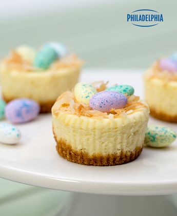Make this unforgettable Easter dessert and enjoy rave reviews from your family and friends. Tap or click photo for this PHILADELPHIA Easter Mini Cheesecakes #recipe.