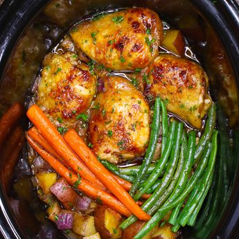 The easiest, most unbelievably delicious Slow Cooker Honey Garlic Chicken With Veggies. It's one of my favorite crock pot recipes. Succulent chicken cooked in honey, garlic, soy sauce and mixed vegetables. Preparation is an easy 15 minutes. Easy one pot recipe. Video recipe. | Tipbuzz.com #SlowCookerChicken