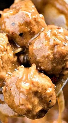 Slow Cooker Meatballs and Gravy - An easy slow cooker or Crockpot recipe for tender and juicy meatballs cooked in a deliciously hearty brown gravy.
