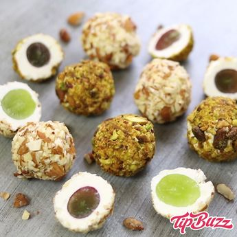 These Grape Cheese Balls are a tasty keto appetizer for holiday entertaining combining a crunchy nutty crust with smooth cream cheese and a juicy grape in the middle. Delicious bite size finger food for a party! #CheeseAppetizers