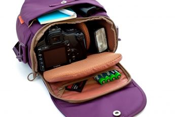 "Camera Day Pack by photojojo: Fits an SLR + lens, flash, memory card, and wallet. Comes with 5 pockets, padded mesh lining, two removable dividers, adjustable padded strap. Fits lenses up to 55mm in length. Dimensions: 6"" deep x 8"" wide. Available also in blue. $60 #Camera_Bag #photojojo"