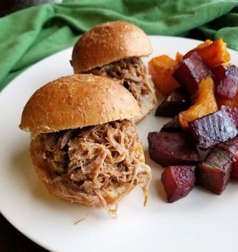 This slightly sweet and slightly spicy pulled pork is easily made in a slow cooker. It is great on a bun, over rice or would make a fun filling for a fusion taco! #pork #slowcooker #dinner #easyrecipe