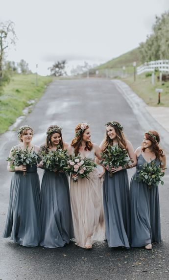Jenny Yoo Bridesmaids, The Inesse  dress features thin spaghetti straps with a V-neckline. The bodice  slightly blouses at the waist that cinches in to add definition around  the natural waist. A long circle skirt creates a romantic look. This  dress is fully lined and has a center back invisible zipper. Shown in a  shade of blue. Available in all Luxe Chiffon colors. Perfect for any  fall, winter, spring or summer wedding. Wedding Photography by Jenny Smith and Co.