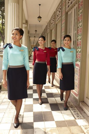 Silk Air cabin crew, triumphant after foiling an attempted inflight hijacking and capturing the two would be terrorists. Senior stewardess Anya Bakari (front) grappled with one of the men for 5 minutes when he attempted to storm the cockpit. With the help of stewardess Eloise Sanchez (first right) she overpowered the man wile flight attendants Sonya Maya (first left) and Suzi Chang (second right) faced down a second terrorist, persuading him to surrender. After the women had securely bound and g