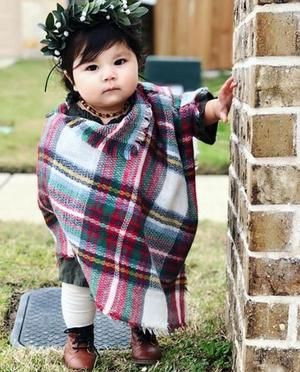 Girls Plaid Ivory Blanket Scarf Poncho  The perfect fall accessory is this soft ivory and red tartan plaid blanket scarf Ponch. Made for your mini to match mom's favourite accessory. Sip pumpkin spice with your little during the fall season sporting these delightful soft tartan plaid blanket scarfs ponchos.